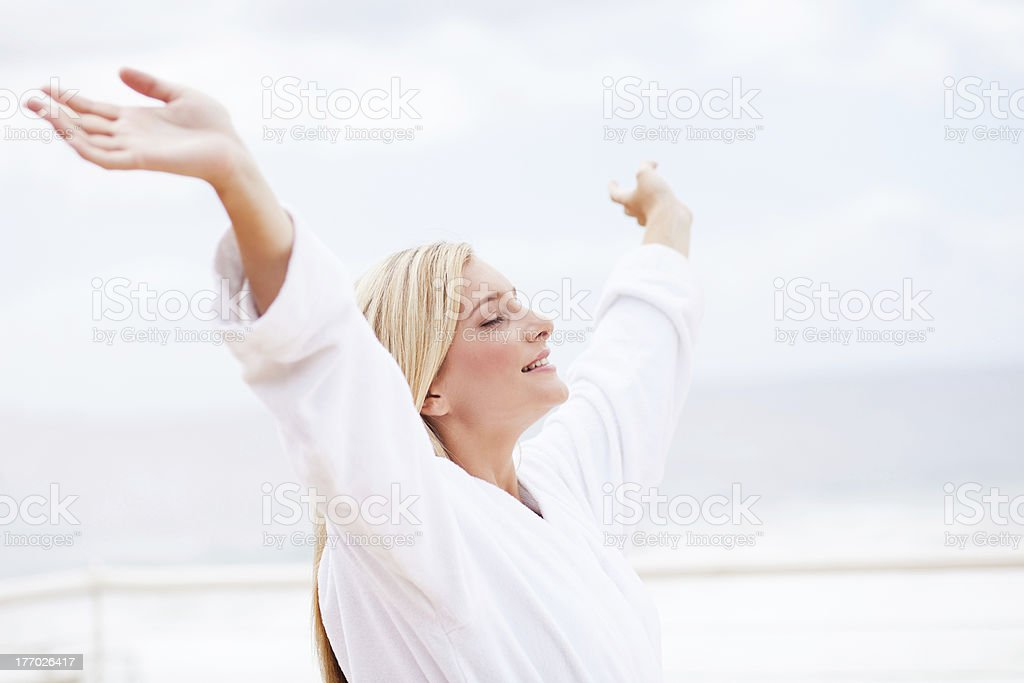 young woman in bathrobe with her arms open royalty-free stock photo