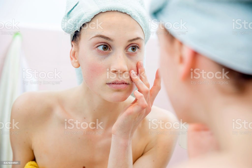 Young woman in bathroom stock photo
