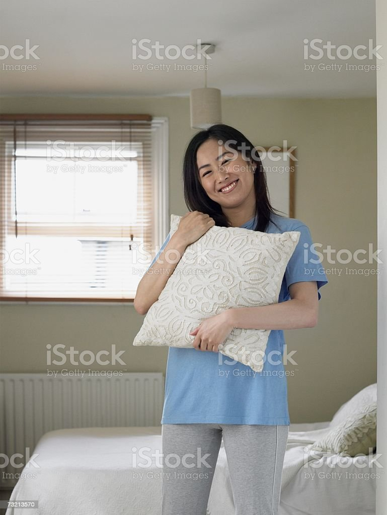 Young woman in bedroom royalty-free stock photo