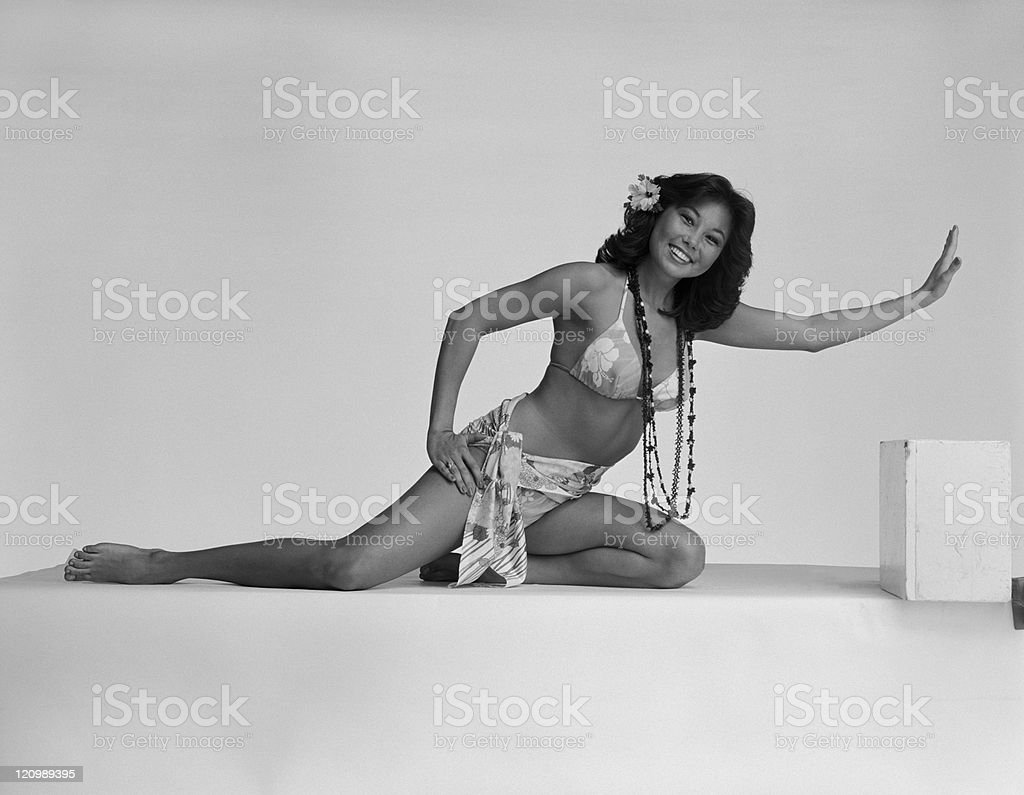 Young woman in bikini on white background, smiling, portrait stock photo