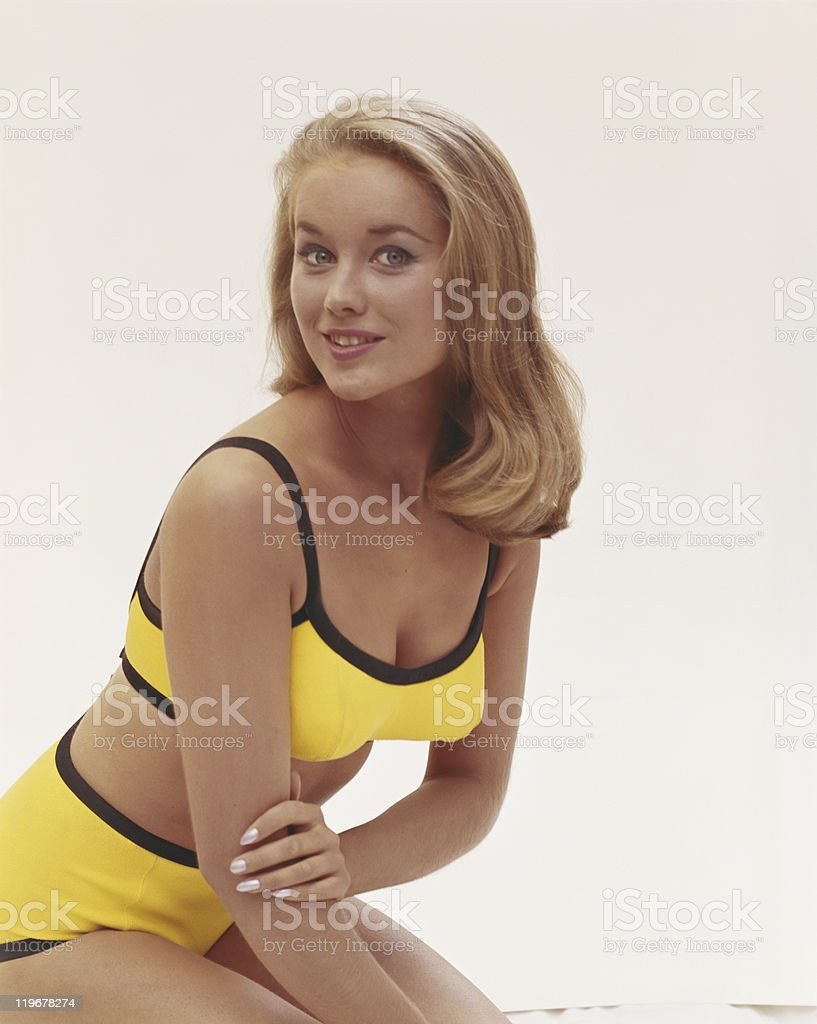Young woman in bikini, smiling, portrait stock photo