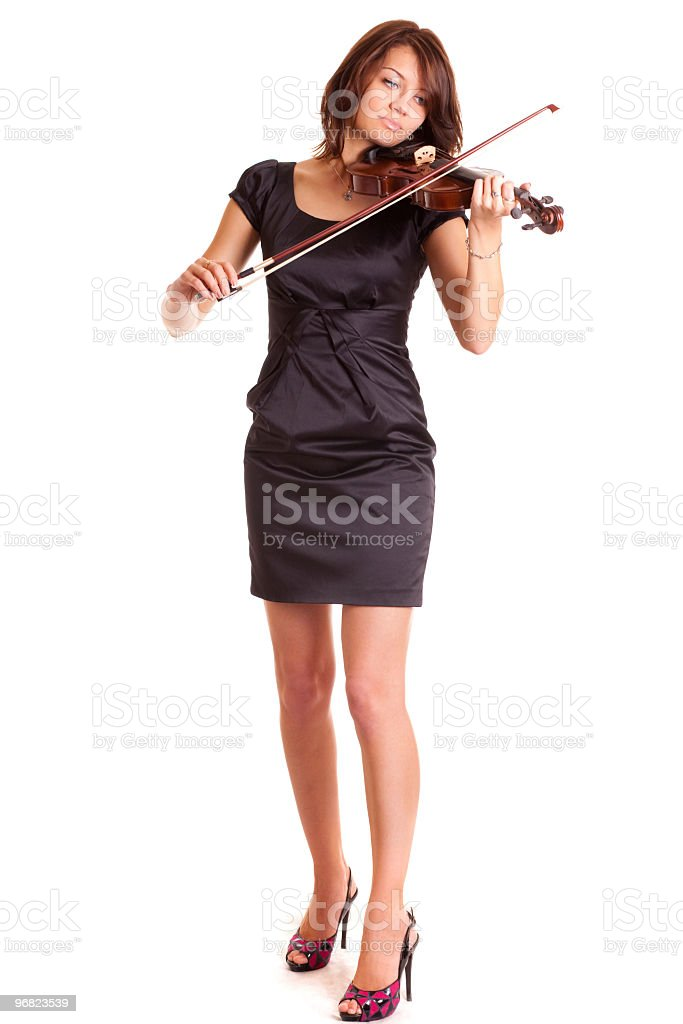 Young woman in black dress playing violin royalty-free stock photo