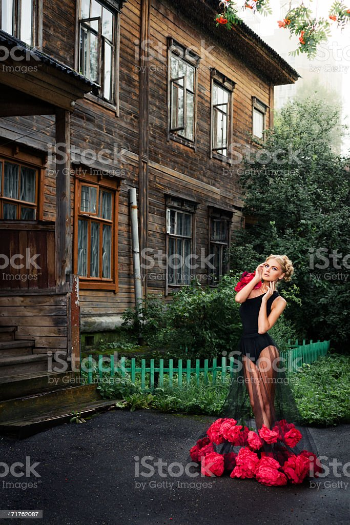 Young woman in black dress with flowers royalty-free stock photo