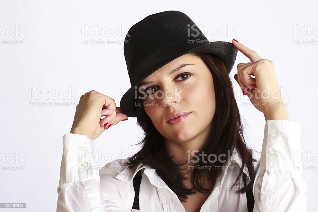 Young woman in black hat with brims royalty-free stock photo