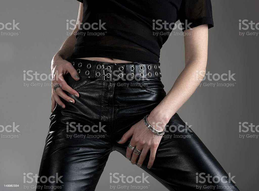 Young woman in black leather pants stock photo