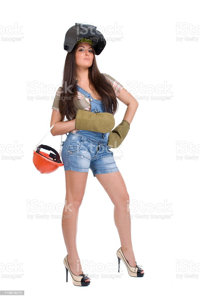 Young woman in black welder`s mask stock photo