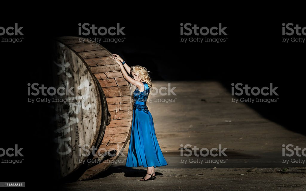 Young woman in blue dress at construction bobbin royalty-free stock photo
