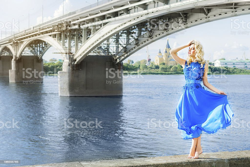 Young woman in blue dress dancing royalty-free stock photo