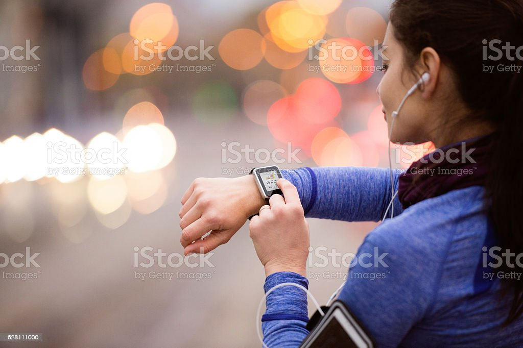 Young woman in blue sweatshirt running in the city stock photo