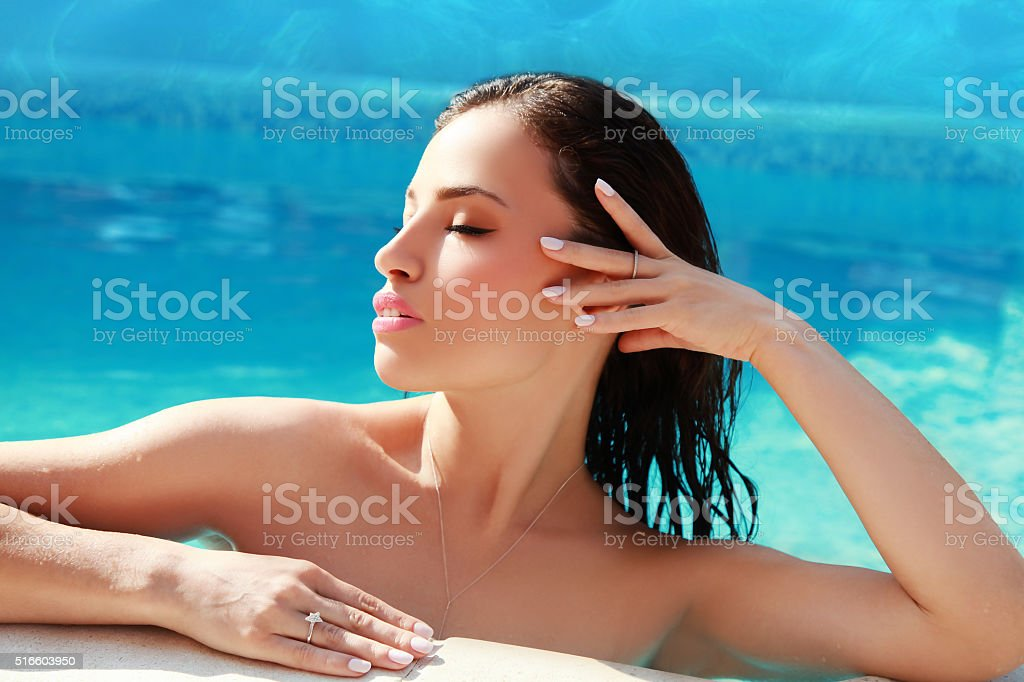 young woman in blue water stock photo