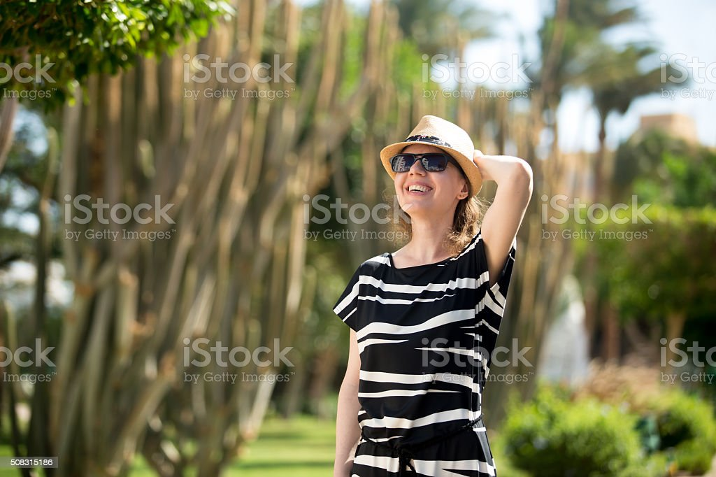 Young woman in botanical garden stock photo