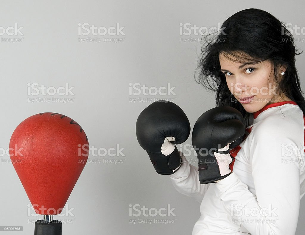 Young woman in boxing gloves stock photo