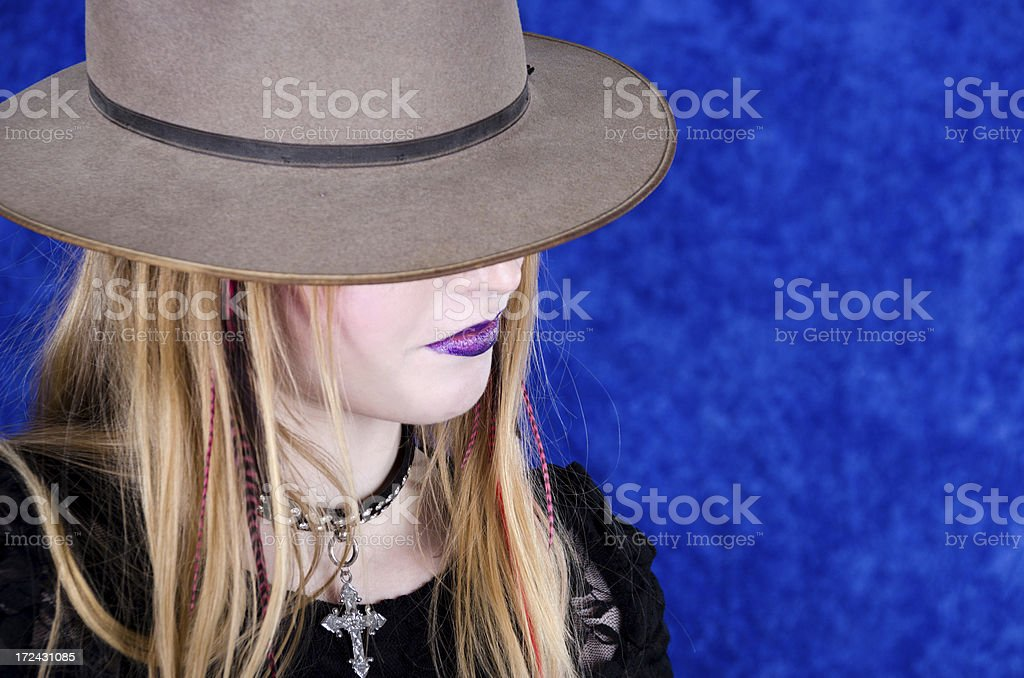 Young woman in brown/gray fedora. royalty-free stock photo