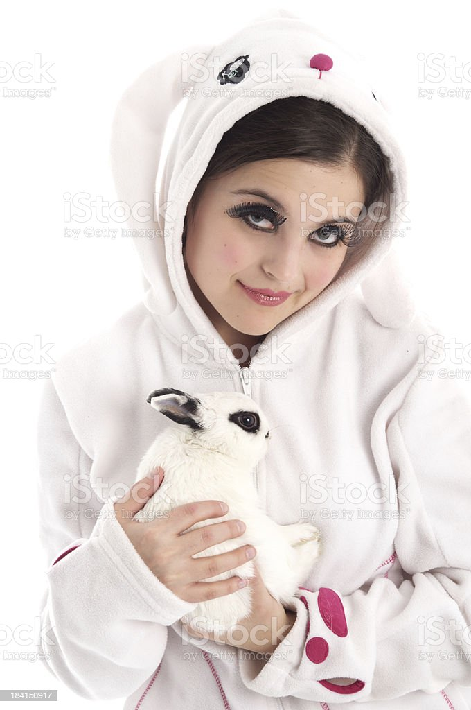 Young woman in bunny hoody holding rabbit. royalty-free stock photo