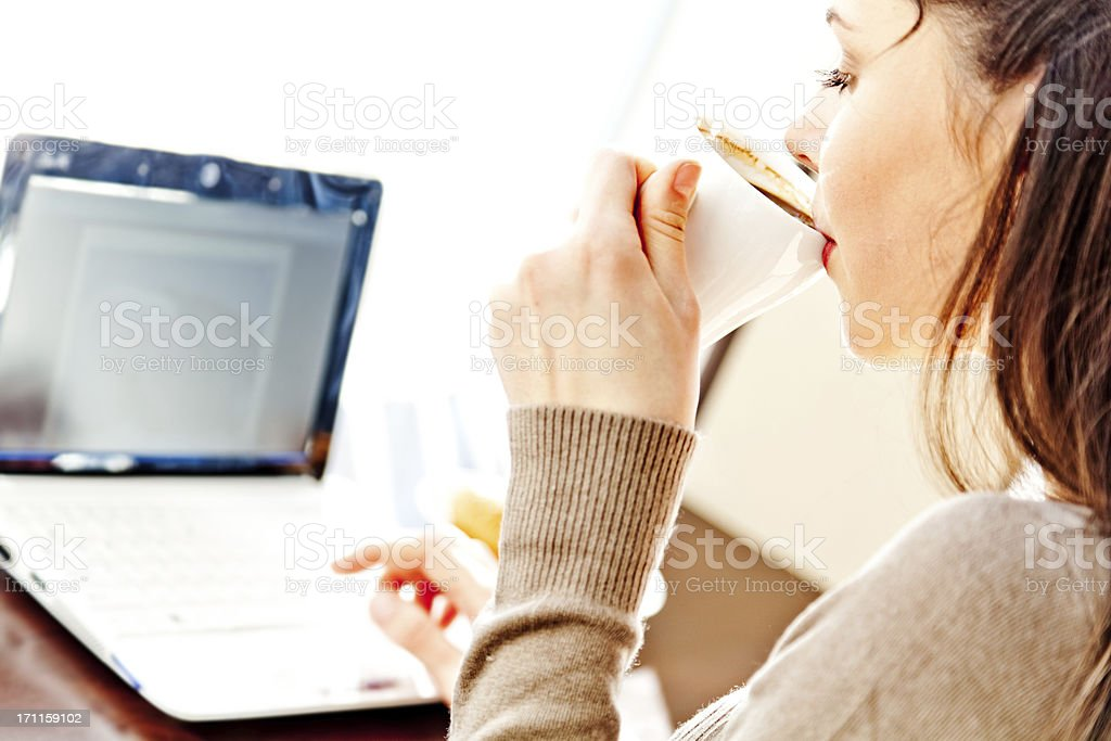 Young woman in cafe with netbook royalty-free stock photo