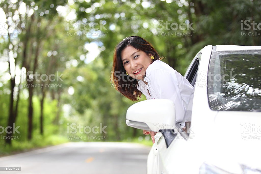 Young woman in car road trip royalty-free stock photo