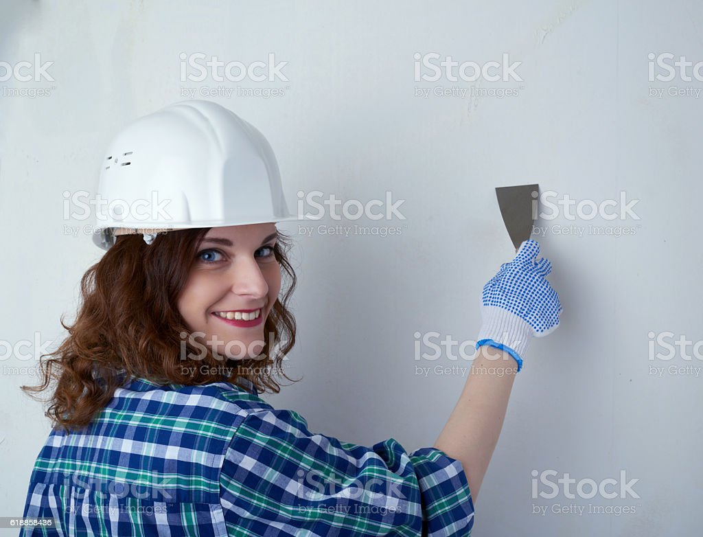 Young woman in casual clothes in front of white wall stock photo