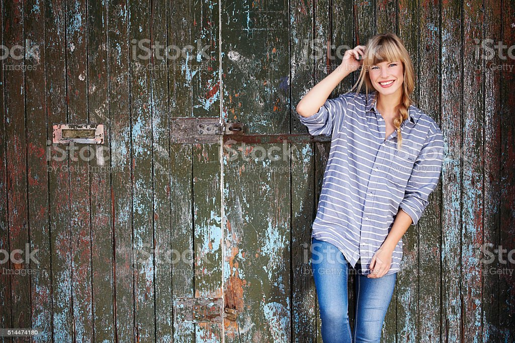 Young woman in casual shirt, smiling stock photo