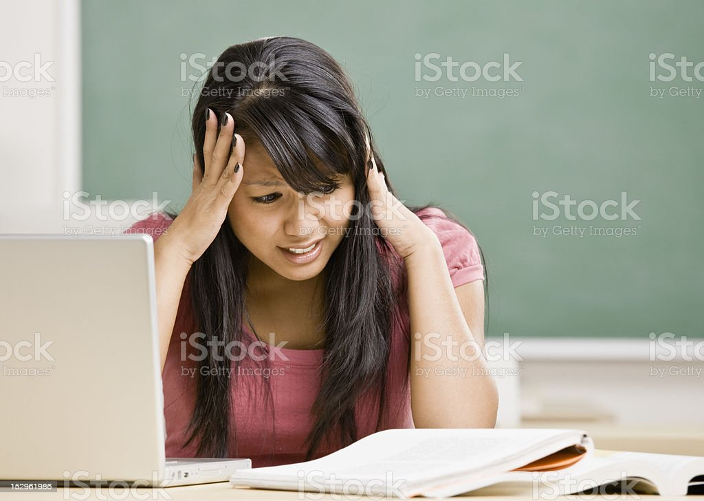 Young Woman in Classroom royalty-free stock photo