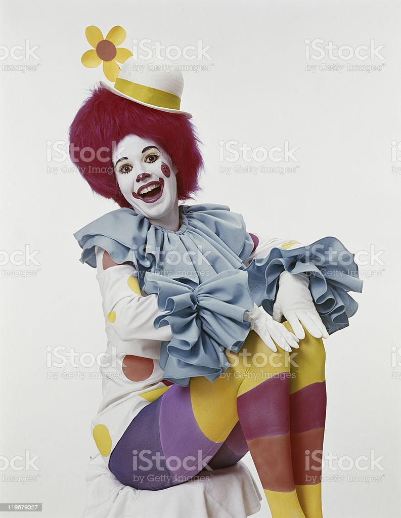 Young woman in clown costume, smiling, portrait royalty-free stock photo