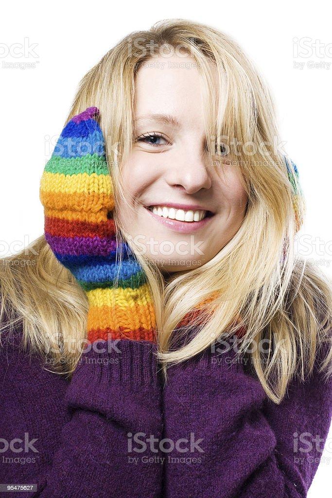 Mujer joven en guantes de colores foto de stock libre de derechos