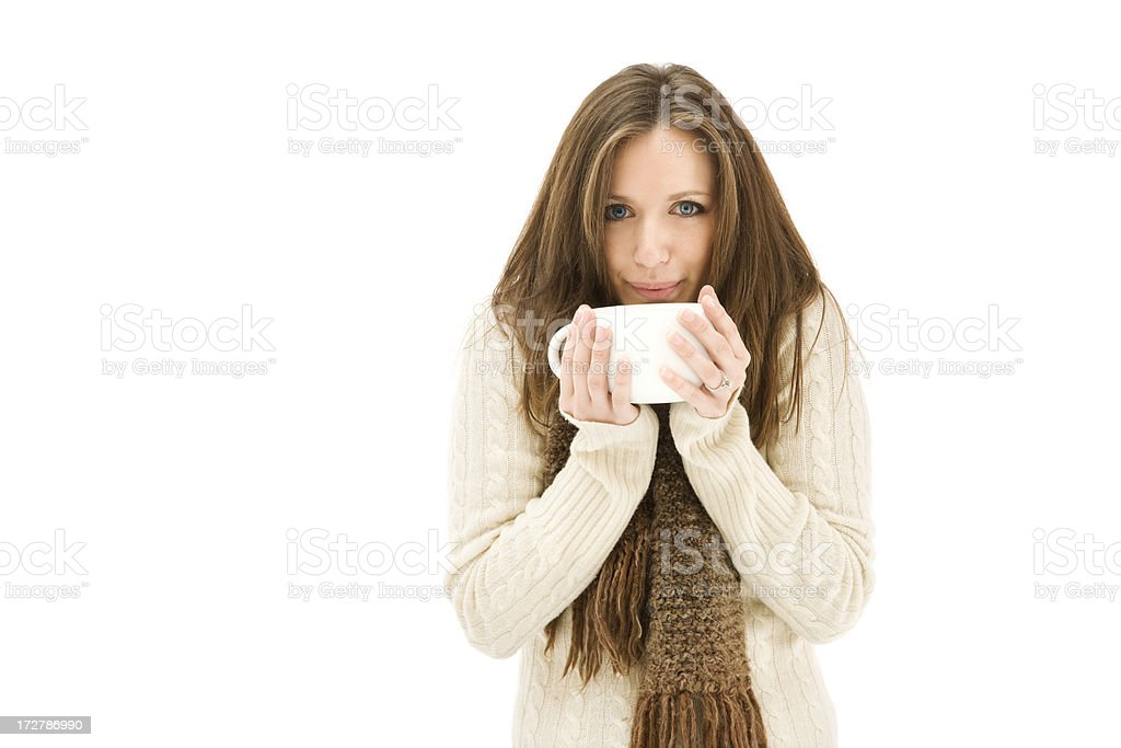 Young Woman in Comfy Sweater Holding Mug royalty-free stock photo