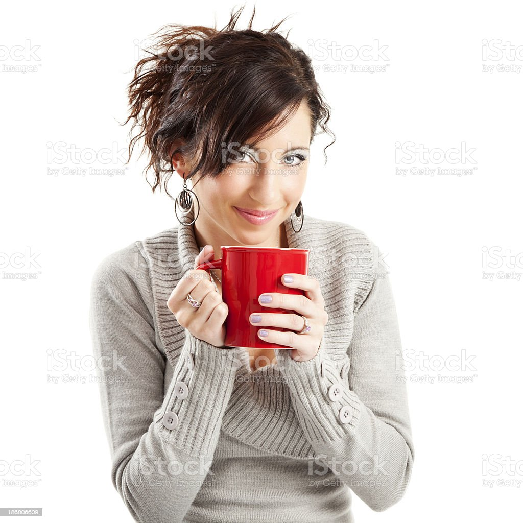 Young Woman in Comfy Sweater Holding Red Coffee Cup royalty-free stock photo