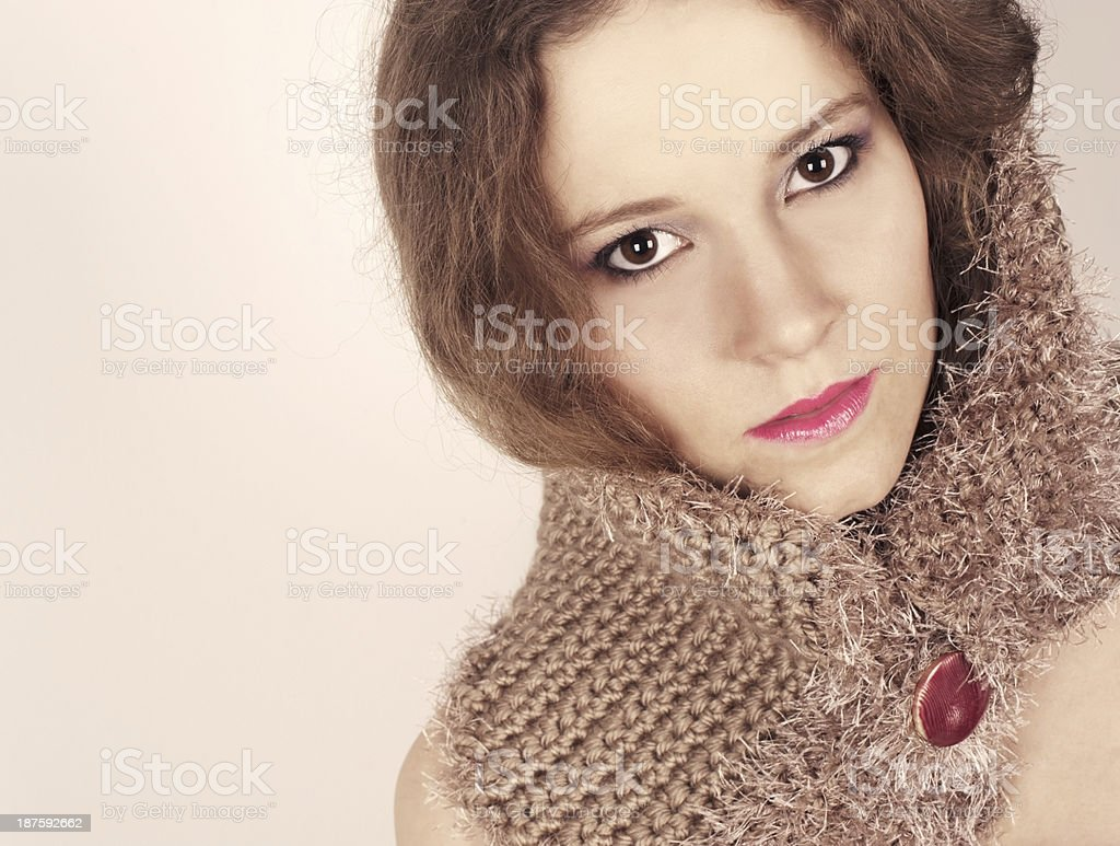 Young Woman in Crocheted Woolen Scarf royalty-free stock photo