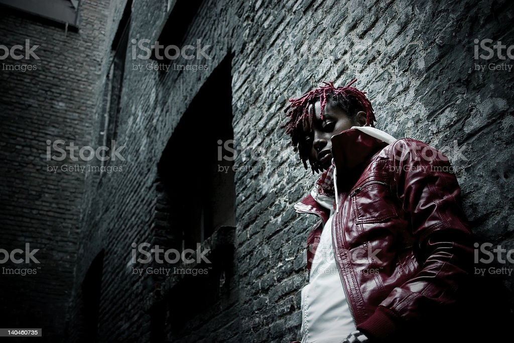 Young Woman in Dark Alley royalty-free stock photo
