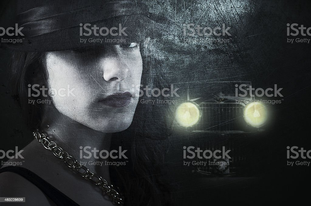 Young woman in dark street stock photo