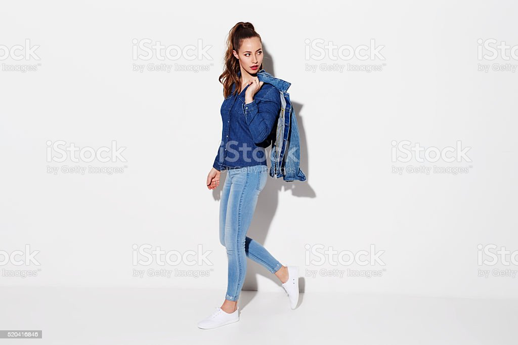 Young woman in denim fashion stock photo
