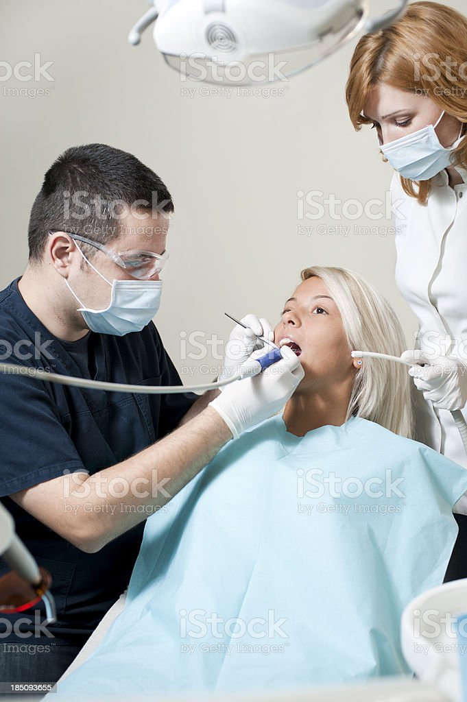 Young woman in dentist office royalty-free stock photo