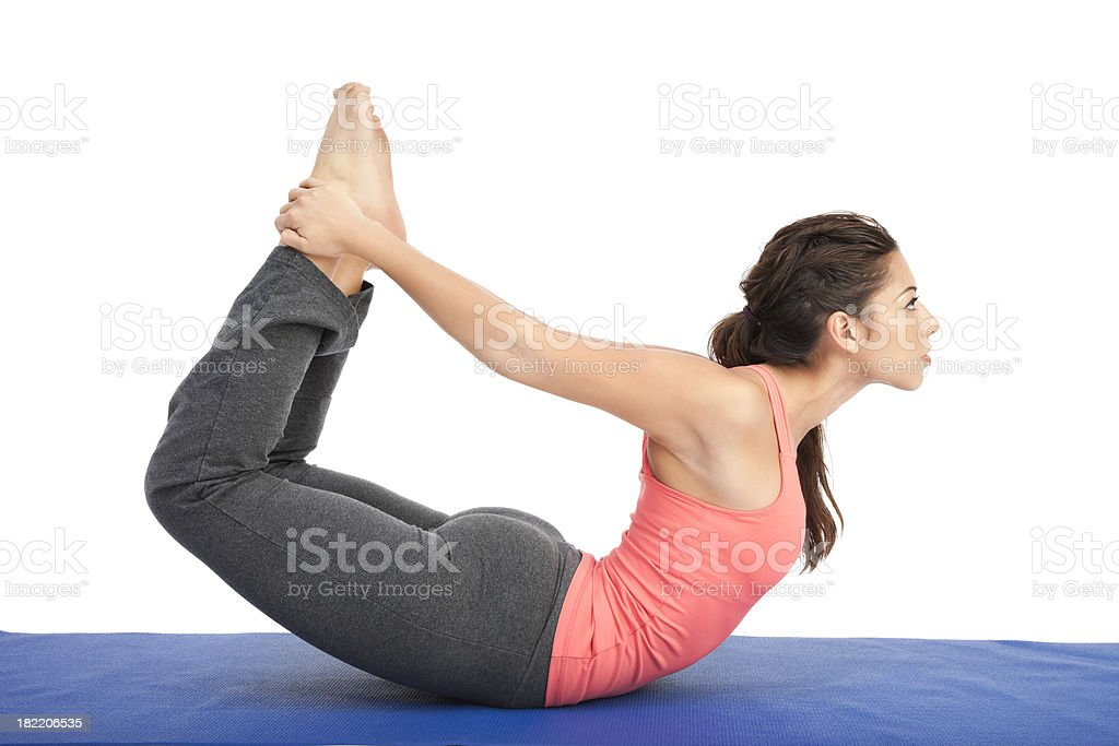 Young Woman in Dhanurasana Yoga Pose stock photo