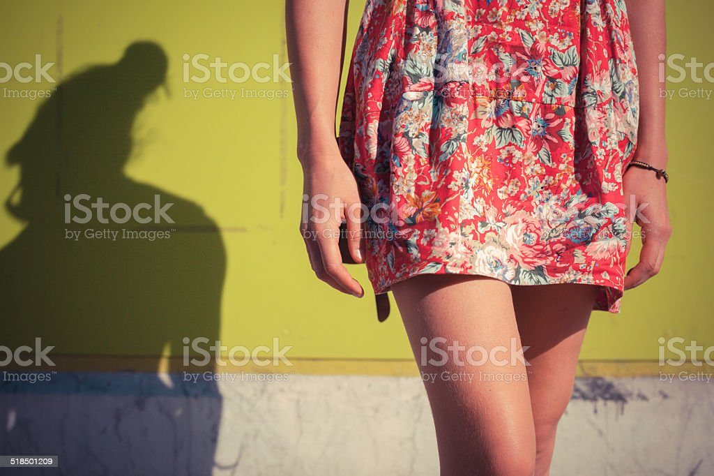 Young woman in dress outside stock photo