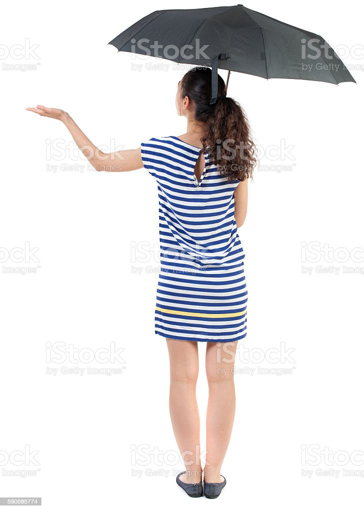 young woman in  dress under an umbrella. stock photo