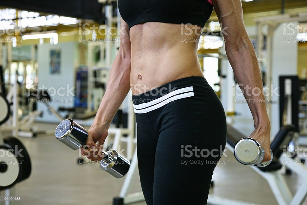 Young woman in fitness center royalty-free stock photo