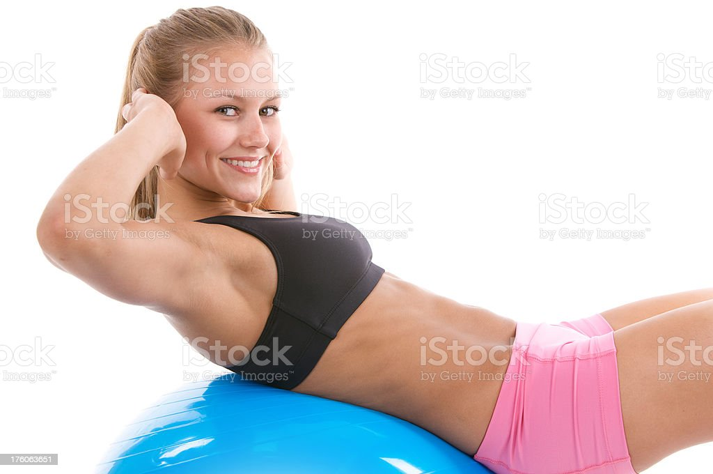 Young woman in fitness wear on stability ball royalty-free stock photo