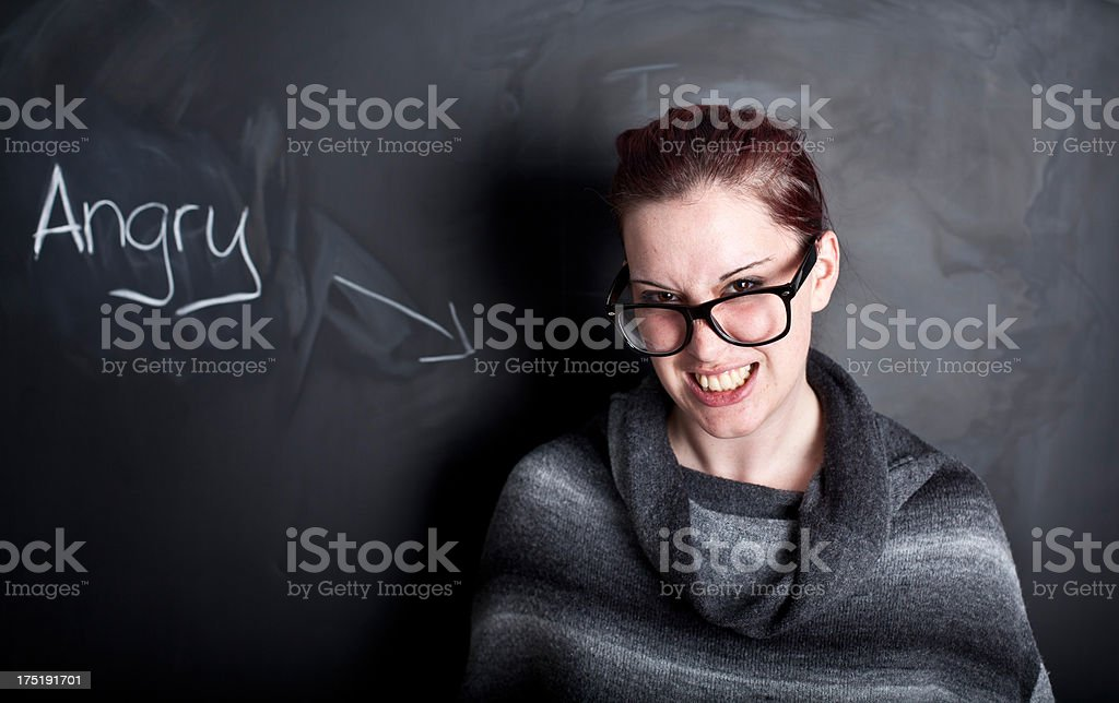 Young woman in front of a chalkboard royalty-free stock photo