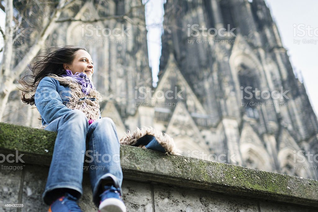 young woman in front of cologne's cathedral royalty-free stock photo