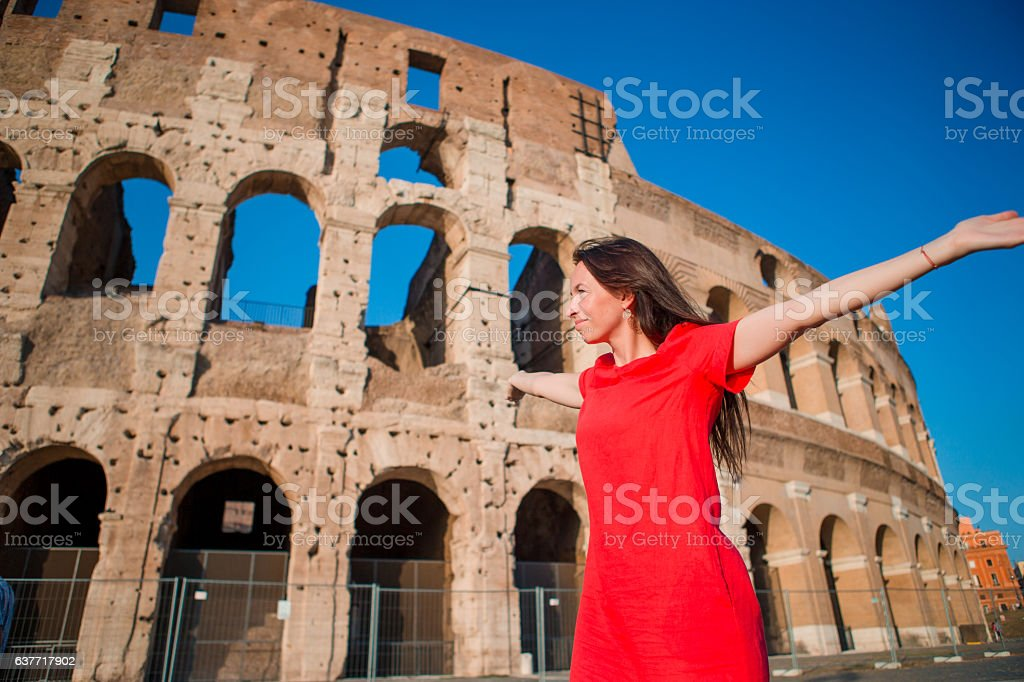 Young woman in front of Colosseum in Rome, Italy. Girl stock photo