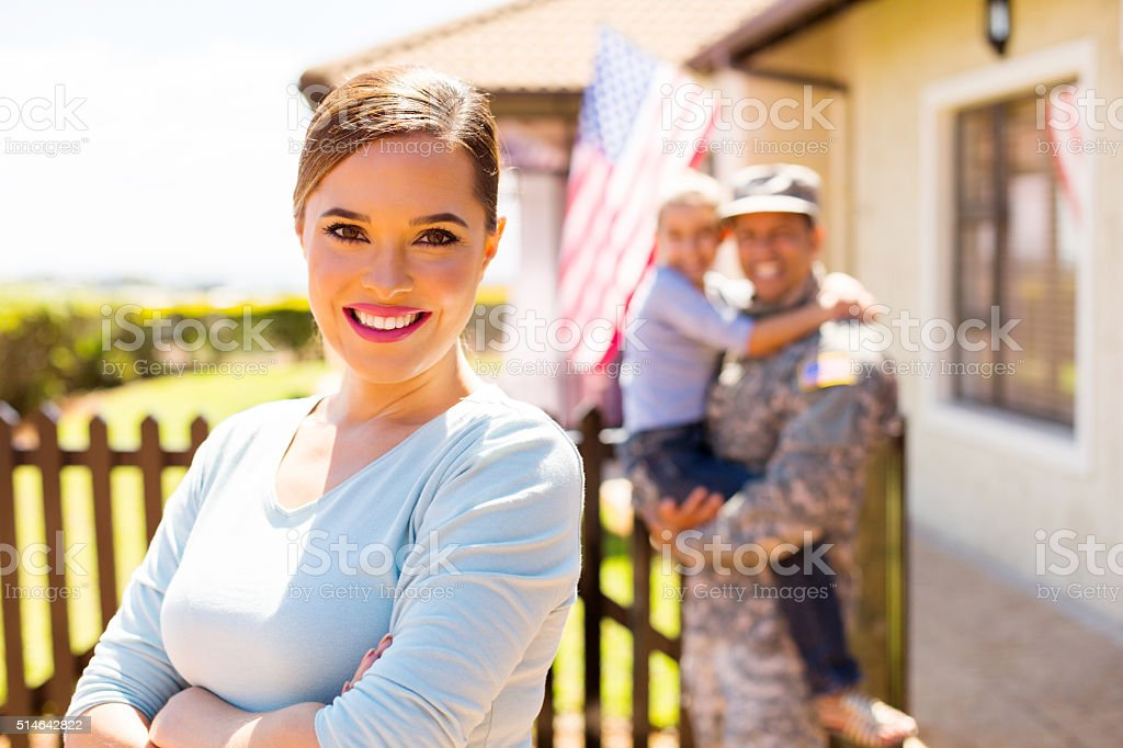 young woman in front of family stock photo