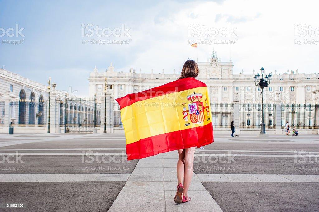 Young woman in front of Palacio de Oriente stock photo