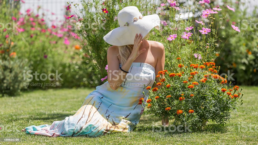 Young Woman in garden stock photo