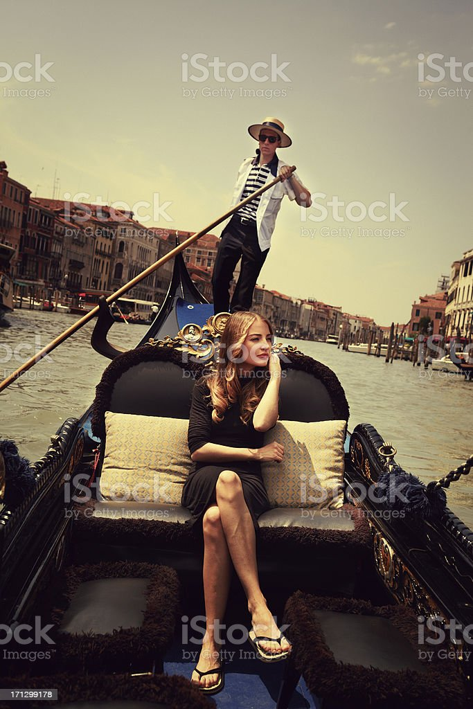 Young woman in gondola, Venice stock photo