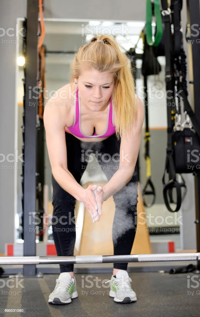 young woman in gym stock photo