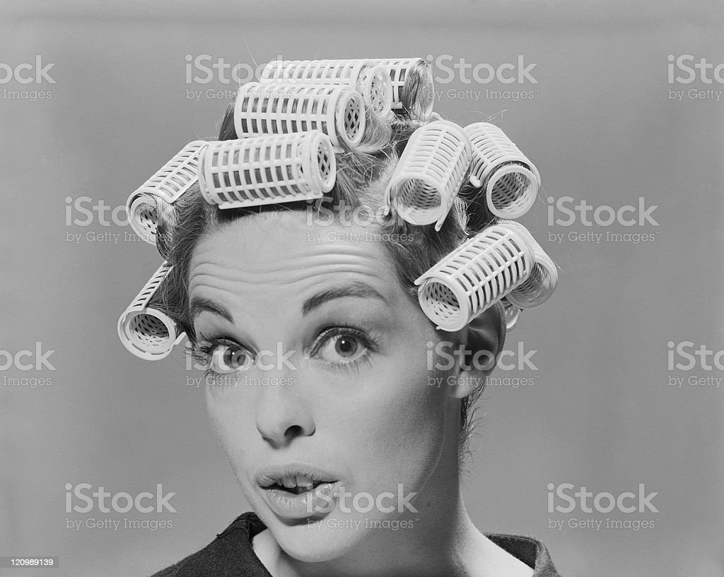 Young woman in hair rollers, portrait stock photo