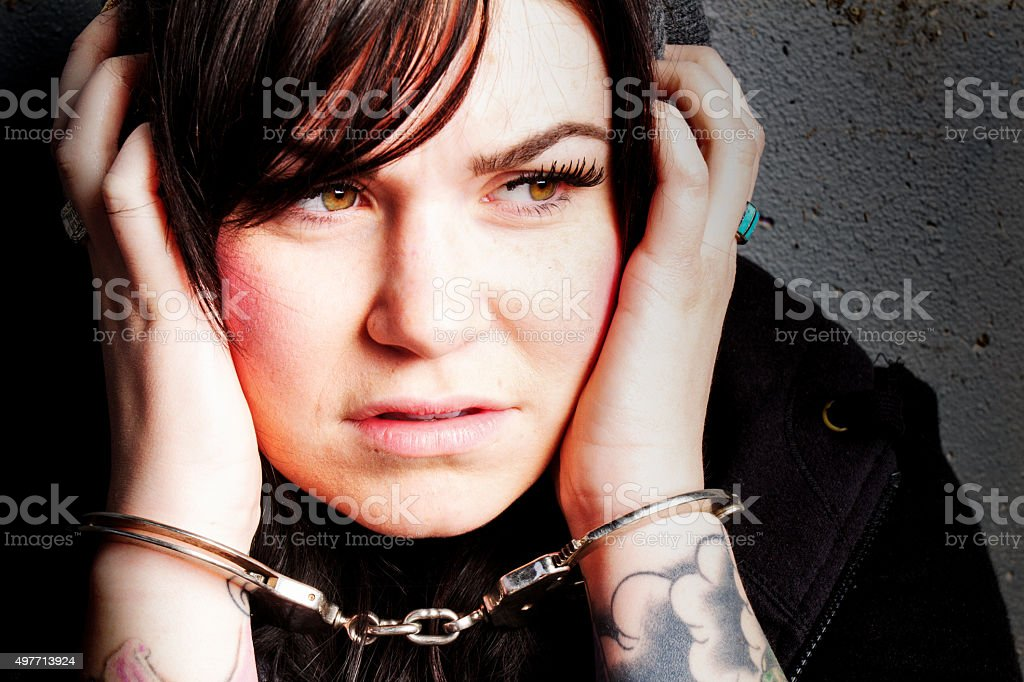 Young Woman in Handcuffs stock photo