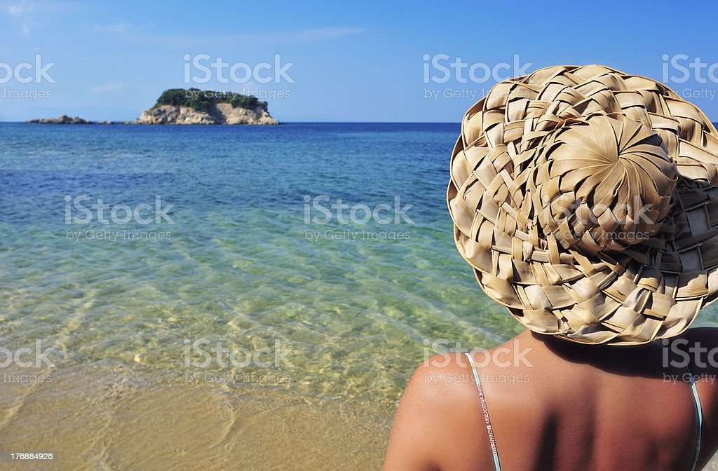 Young woman in hat looking at small island royalty-free stock photo