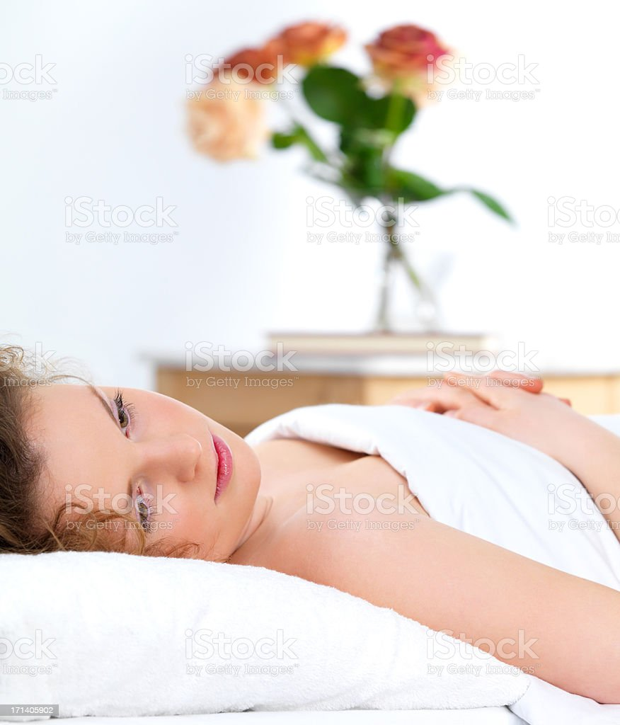 Young woman in her bed royalty-free stock photo