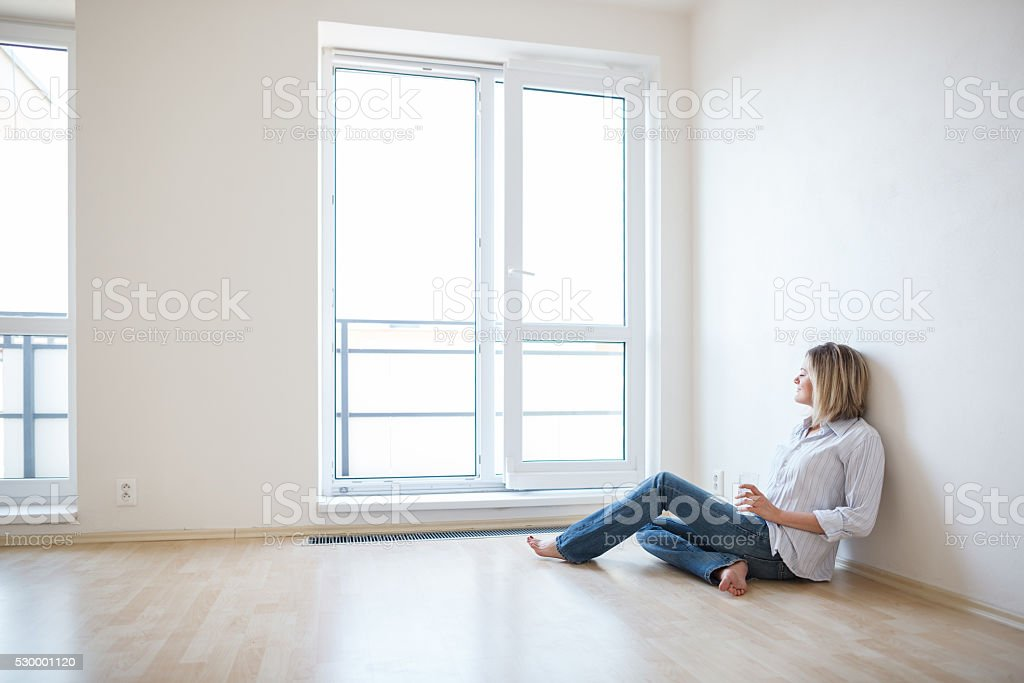 Young woman in her new apartment stock photo